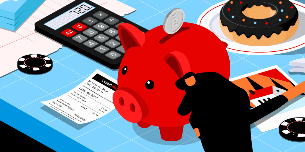 A red piggy bank on a blue table with a Casinopro receipt, a calculator, some casino chips and a donut