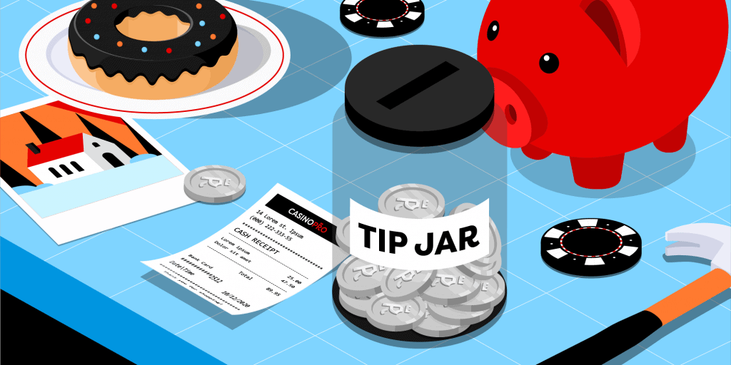 A tip jar filled with Casinopro coins on a blue table, with a piggy bank, casino chips, a receipt, a hammer and a donut